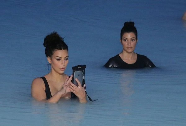 kim-kardashian-in-water-with-phone